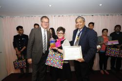 Image shows Judy receiving her award from Keith Parton of Clariant (left) and SDC President Dr Sanjiv Kamat.